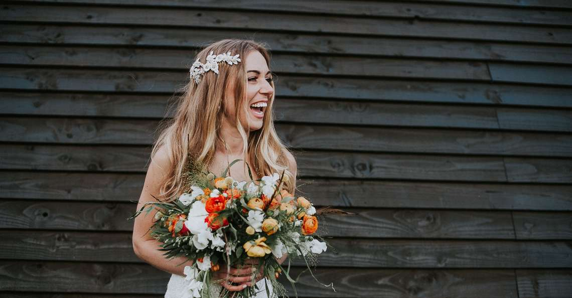 smiling bride and bouquet luxury glamping pods northside farm