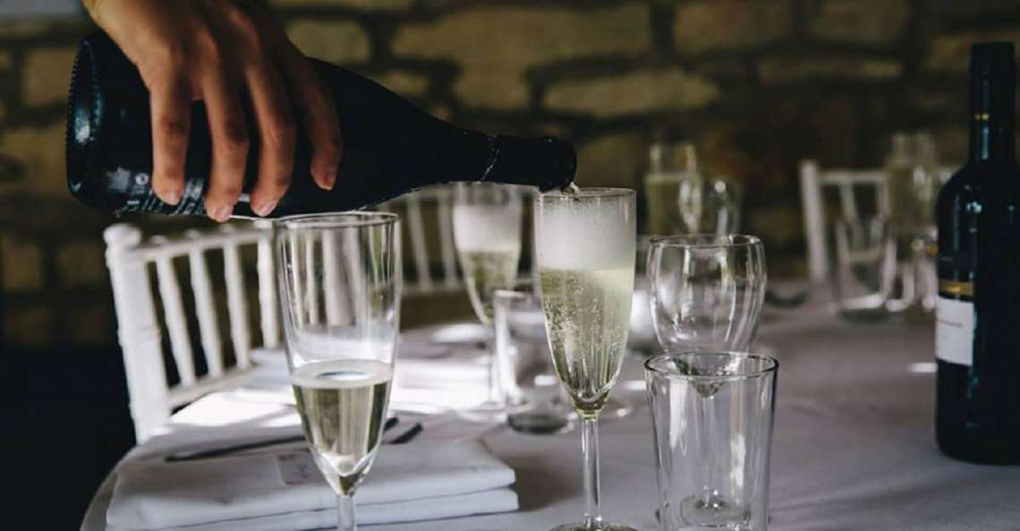 champagne toast serving alcohol at your wedding