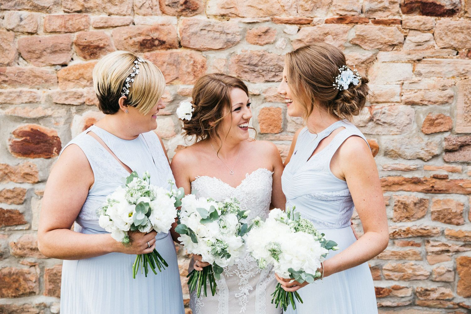 Bride and her bridesmaids smiling