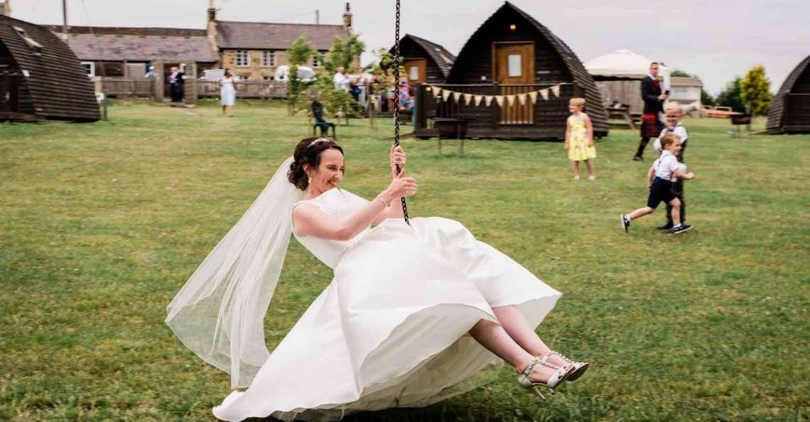 Bride on zip line northside farm laidback, luxury wedding in northumberland