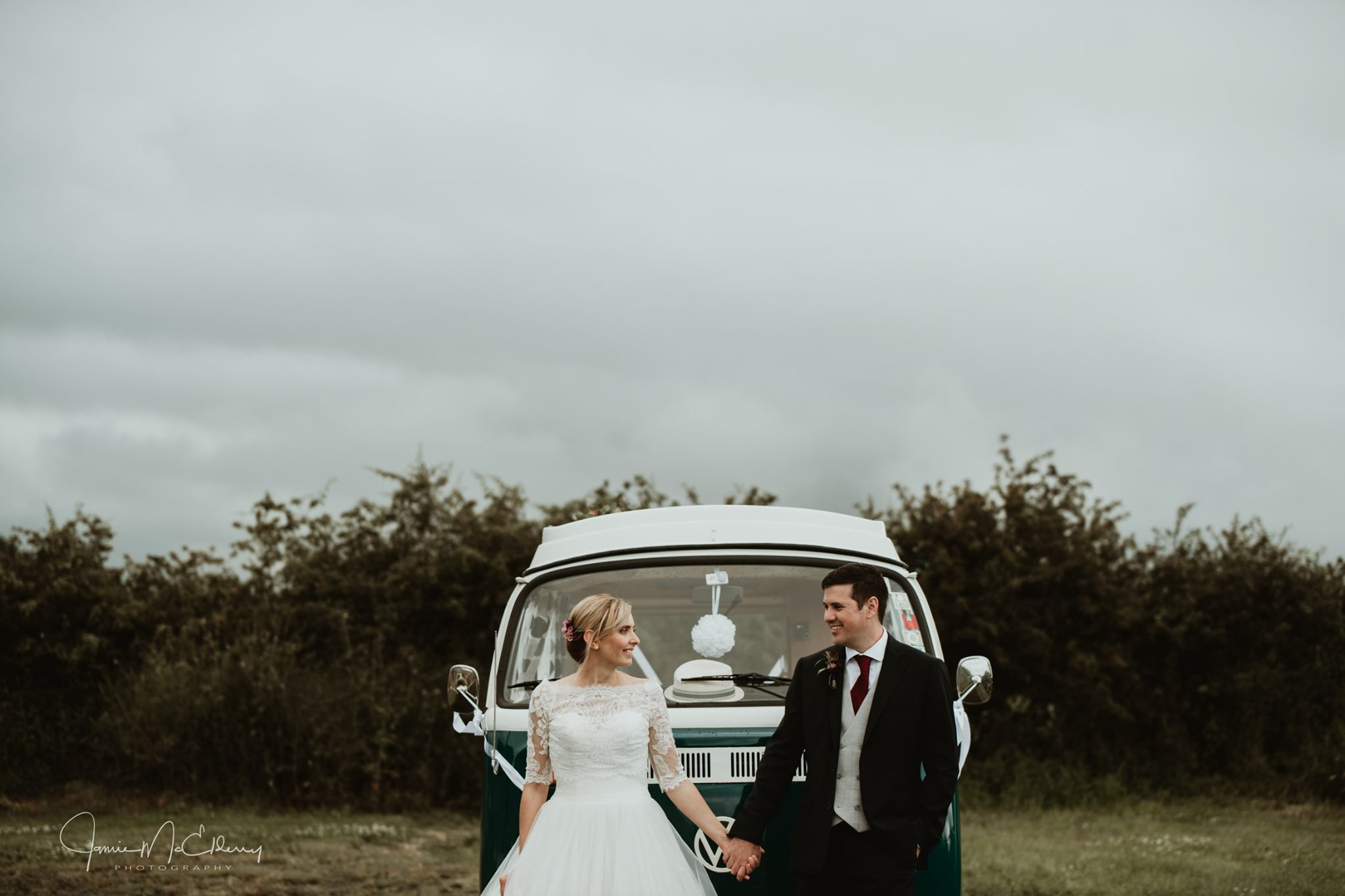 bride and groom with VW camper van