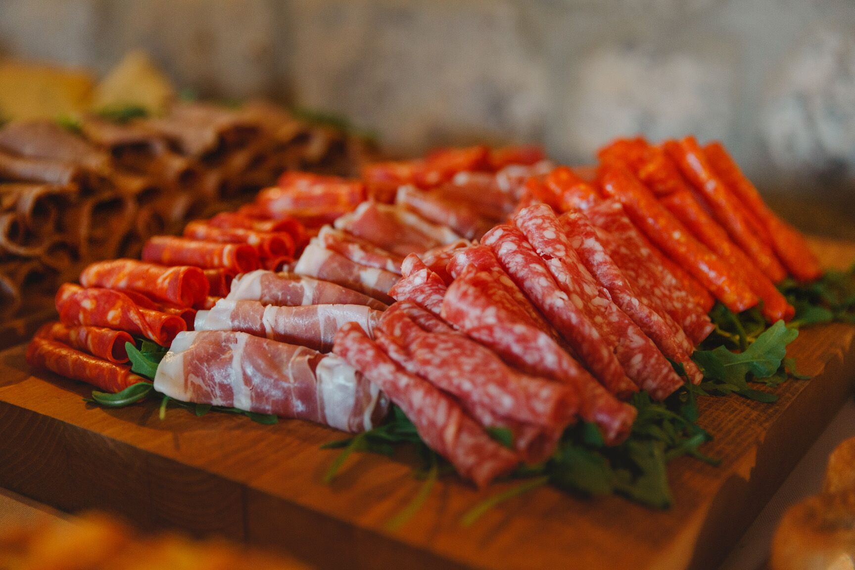 cold meats on wooden servig board wedding evening food ideas