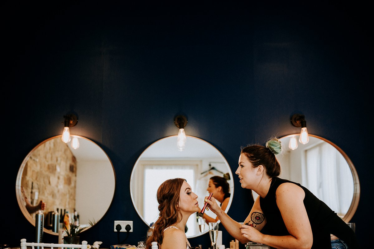 makeup artist working on bridesmaid makeup at northside farm