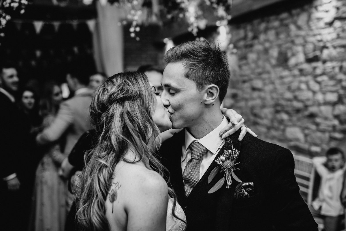 black and white photo bride and groom kissing northside farm wedding