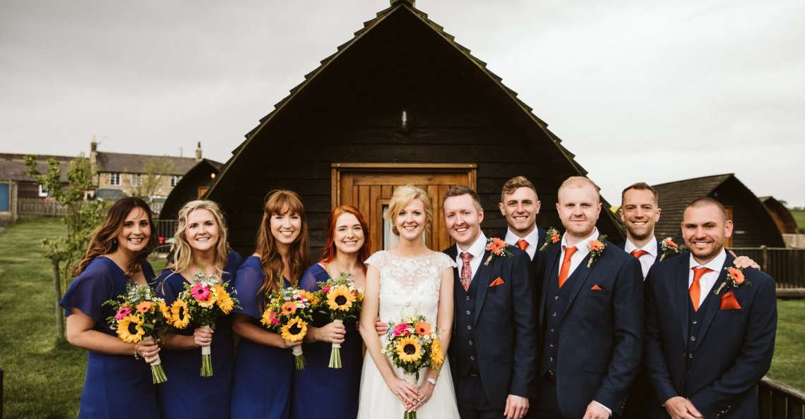 Summer wedding Northside Farm bride and bridesmaids with sunflower bouquets